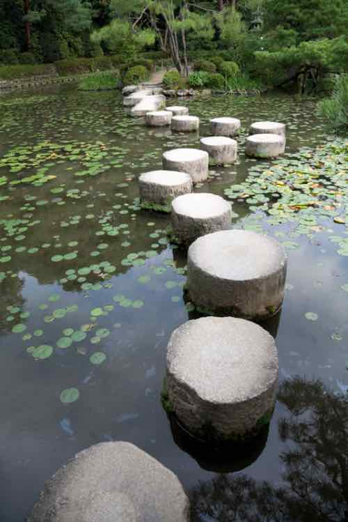 Zen pond with stepping stones